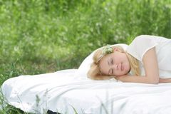 Young beautiful woman relaxing on nature Royalty Free Stock Images