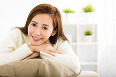 Young beautiful woman relaxing on sofa Royalty Free Stock Photography