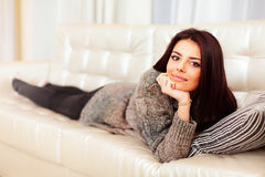 Young beautiful woman relaxing on sofa Stock Photo