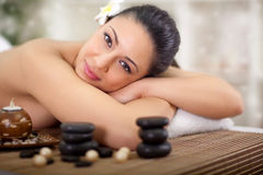Young beautiful woman relaxing in spa center Stock Image