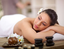 Young beautiful woman relaxing in spa center Royalty Free Stock Photography