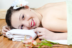 Young beautiful woman relaxing in spa salon Stock Photo