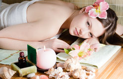 Young beautiful woman relaxing in spa salon Royalty Free Stock Photo