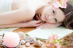 Young beautiful woman relaxing in spa salon Royalty Free Stock Photos