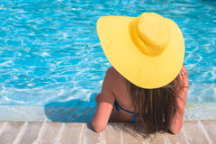 Young beautiful woman relaxing in swimming pool Royalty Free Stock Photo