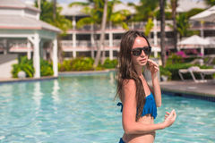 Young beautiful woman relaxing in swimming pool Royalty Free Stock Photography
