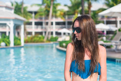 Young beautiful woman relaxing in swimming pool Stock Image