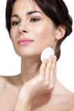 Young beautiful woman remove makeup from perfect skin Royalty Free Stock Photos