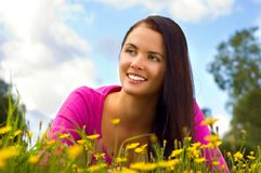 Young beautiful woman resting on the meadow. Over the sky stock photos