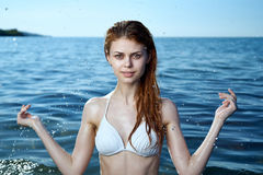 Young beautiful woman is resting on the sea, vacation, beach, ocean Royalty Free Stock Photography