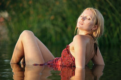 Young beautiful woman resting in water stock photos