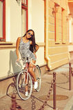 Young beautiful woman with retro bicycle, outdoor summer portrai Stock Images
