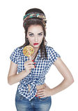 Young beautiful woman in retro pin up style with lollipop isolat Royalty Free Stock Image