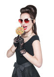 Young beautiful woman in retro pin up style with lollipop Stock Photos