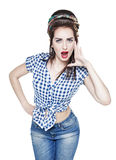 Young beautiful woman in retro pin up style shouting with her ha Royalty Free Stock Photos