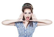 Young beautiful woman in retro pin up style shouting with her ha Royalty Free Stock Photo