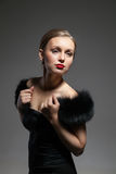 Young and beautiful woman in retro style with fur. Portrait of young and beautiful woman in retro style with fur Stock Photo
