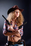 Young Beautiful Woman With A Revolver Royalty Free Stock Image