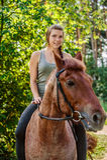 Young beautiful woman rides horse Stock Photos