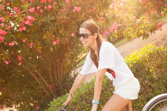 Young beautiful woman riding bicicle on summer Royalty Free Stock Photography