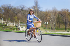 Young beautiful woman riding a bicycle in a park. Active people. Royalty Free Stock Images