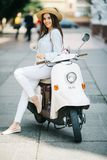 Young beautiful woman riding on motorbike city street, summer europe vacation, traveling. Young beautiful woman riding on motorbike city street, summer europe Stock Image