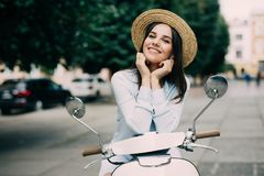 Young beautiful woman riding on motorbike city street, summer europe vacation, traveling. Young beautiful woman riding on motorbike city street, summer europe Stock Images