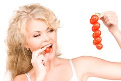 Young beautiful woman with ripe tomatoes Royalty Free Stock Images