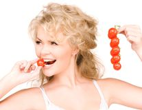 Young beautiful woman with ripe tomatoes Royalty Free Stock Image