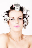 Young beautiful woman with rollers in hair Royalty Free Stock Photos