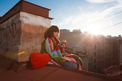 Young beautiful woman on the roof with an umbrella. Romantic wal Stock Photos