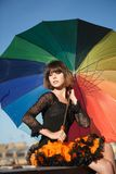 Young beautiful woman on the roof with an umbrella. Romantic wal. K model girls on the sky background Stock Photography