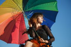 Young beautiful woman on the roof with an umbrella. Romantic wal. K model girls on the sky background Royalty Free Stock Photo