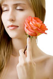 Young beautiful woman with rose Stock Photography