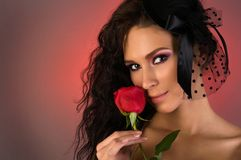 Young beautiful woman with rose in her Stock Image
