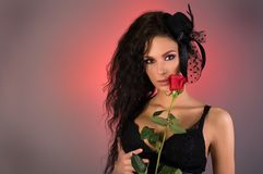 Young beautiful woman with rose in her Stock Photos