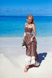 The young beautiful woman with a rose near the sea, tropics Stock Photos