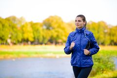 Young Beautiful Woman Running in the Autumn Park Stock Photography
