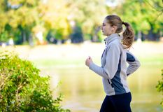 Young Beautiful Woman Running in the Autumn Park Royalty Free Stock Images