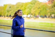 Young Beautiful Woman Running in the Autumn Park Royalty Free Stock Image