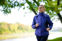 Young Beautiful Woman Running in the Autumn Park Royalty Free Stock Photos