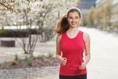 Young beautiful woman running in the city Royalty Free Stock Images