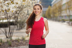 Young beautiful woman running in the city Royalty Free Stock Photo