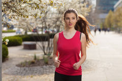 Young beautiful woman running in the city Royalty Free Stock Photography