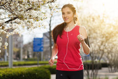 Young beautiful woman running in the city royalty free stock photos