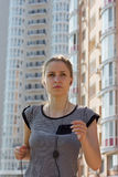 Young beautiful woman running in city street Stock Photography