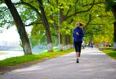 Free Young Beautiful Woman Running In The Autumn Park Royalty Free Stock Image - 46341666