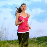 Young Beautiful Woman Running on the Mountain Trail in the Morning Stock Image