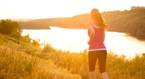 Young Beautiful Woman Running on the Mountain Trail in the Morning Royalty Free Stock Image