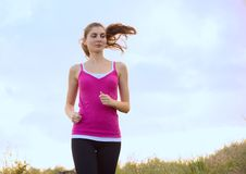 Young Beautiful Woman Running on the Mountain Trail in the Morning Stock Images